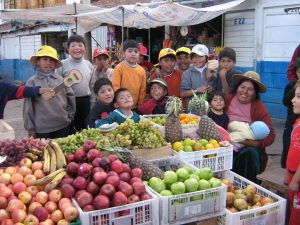 Children of Pro Mujer group members in the market