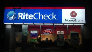 Ritecheck storefront at night
